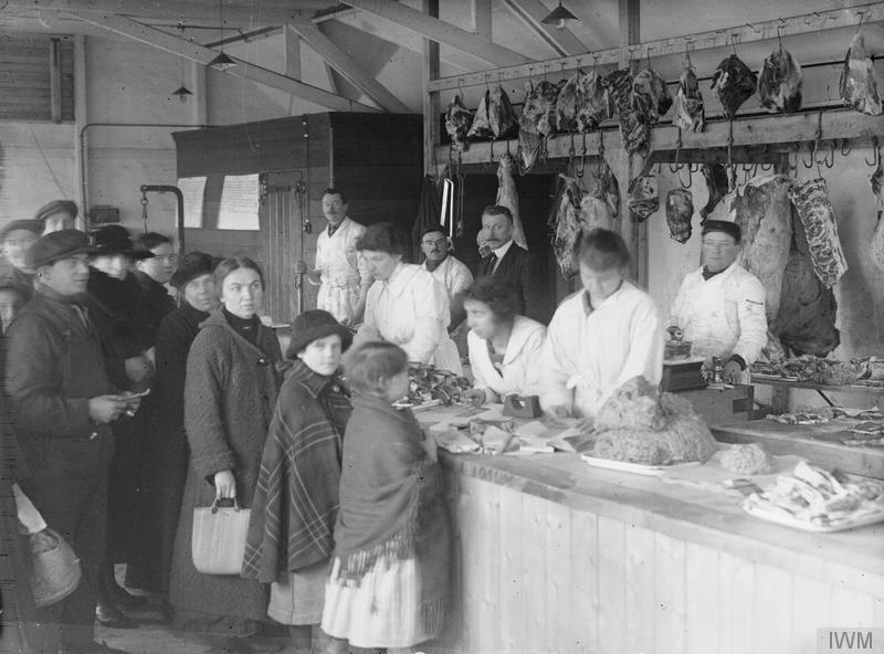Colony of Belgian workers in Britain. Customers being served in a butcher's shop in Birtley-Elisabethville, County Durham, 1918